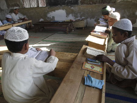 Rohingya children studying the Quran at the Madrassa