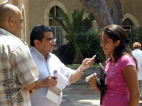 2008-08-03-SaudijournalistsHasanAlMustafaandMansourAlNogaidaninterviewAUBstudentfortheirblog.jpg