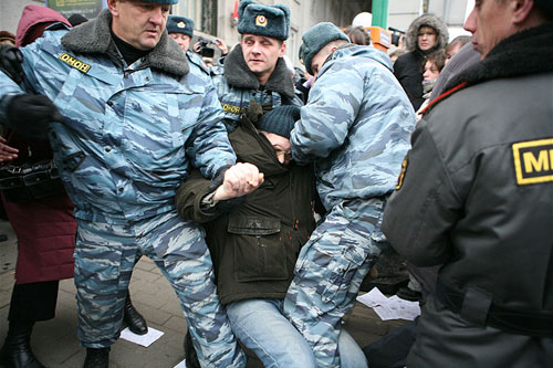 Riot police arrests a peaceful protester in the center of Moscow