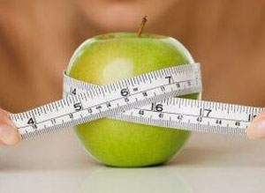 losing weight apple tape measure photo
