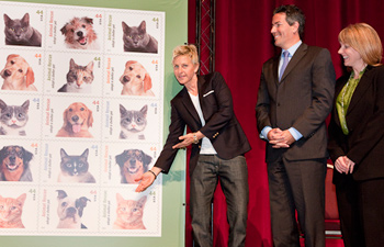With Ellen DeGeneres and Betsy Saul, Co-Founder of Petfinder.com Photo credit Clemente Bogle, Jr./U.S. Postal Service