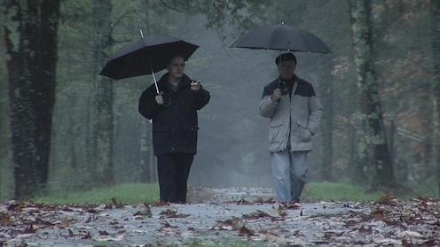 2010-10-07-Menachem_and_Fred_walkinginrain.jpg