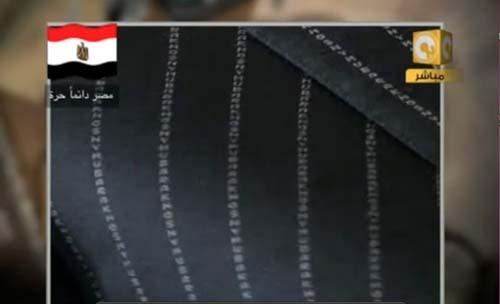 2011-03-13-HosniMubarakssuitwithhisnameinpinstripesAbuFadil.jpg