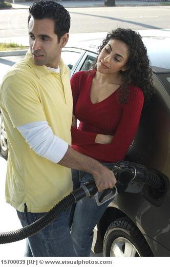 2011-03-22-couple_pumping_gas_15700039.jpg