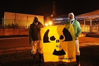 Kumi Naidoo Executive Director of Greenpeace International (left) and Tobias Muenchmeyer, Nuclear Expert Greenpeace Germany (right) hold an anti-nuclear banner in the very minute of the Chernobyl 25th anniversary.