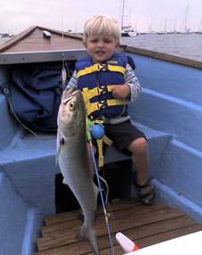 young fisherman with bluefish