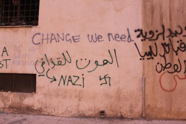 2011-08-30-AntiQaddafiGraffitiChangeWeNeedBenghaziLibya.jpg