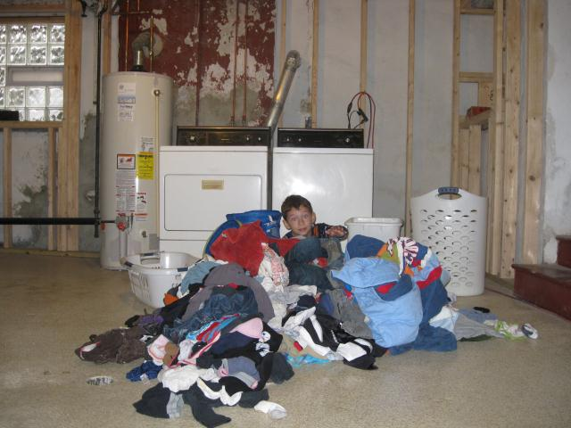 2012-01-26-8yearoldburiedinlaundry.jpg
