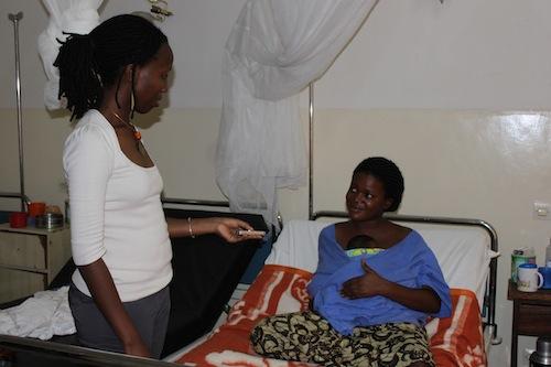 2012-02-16-GloriainterviewingmotherinKangarooCareKigaliRwandaMay142011JPG.JPG