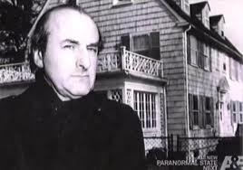 Dr. Hans Holzer in-front of The Amityville House, Amity, Long Island.