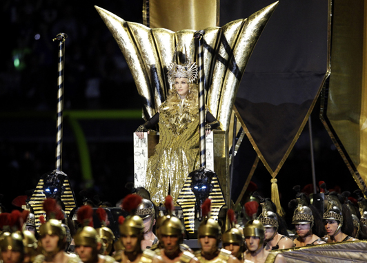 2012-03-23-MADONNAgoldcapethrone.jpg