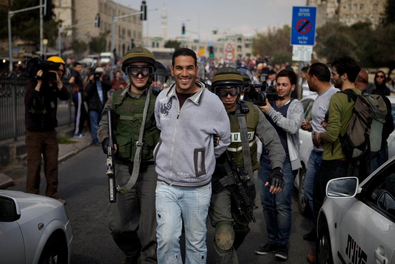 2012-06-12-smilingprotester.jpeg