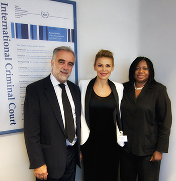 Luis Moreno-Ocampo, Outgoing Chief Prosecutor of the International Criminal Court in The Hague, Diana Jenkins, and Fatou Bensouda, the Incoming Chief Prosecutor, meet at the ICC on May 31, 2012.