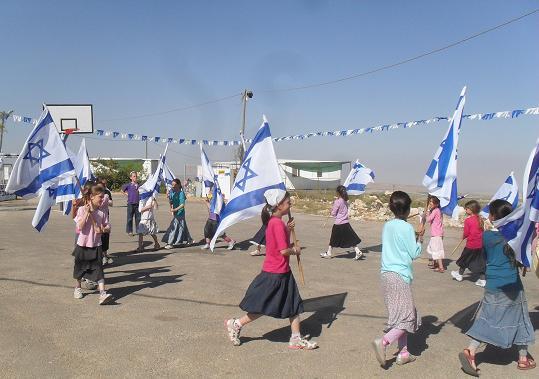 2012-06-15-MigronKidsIsraeliFlags.JPG