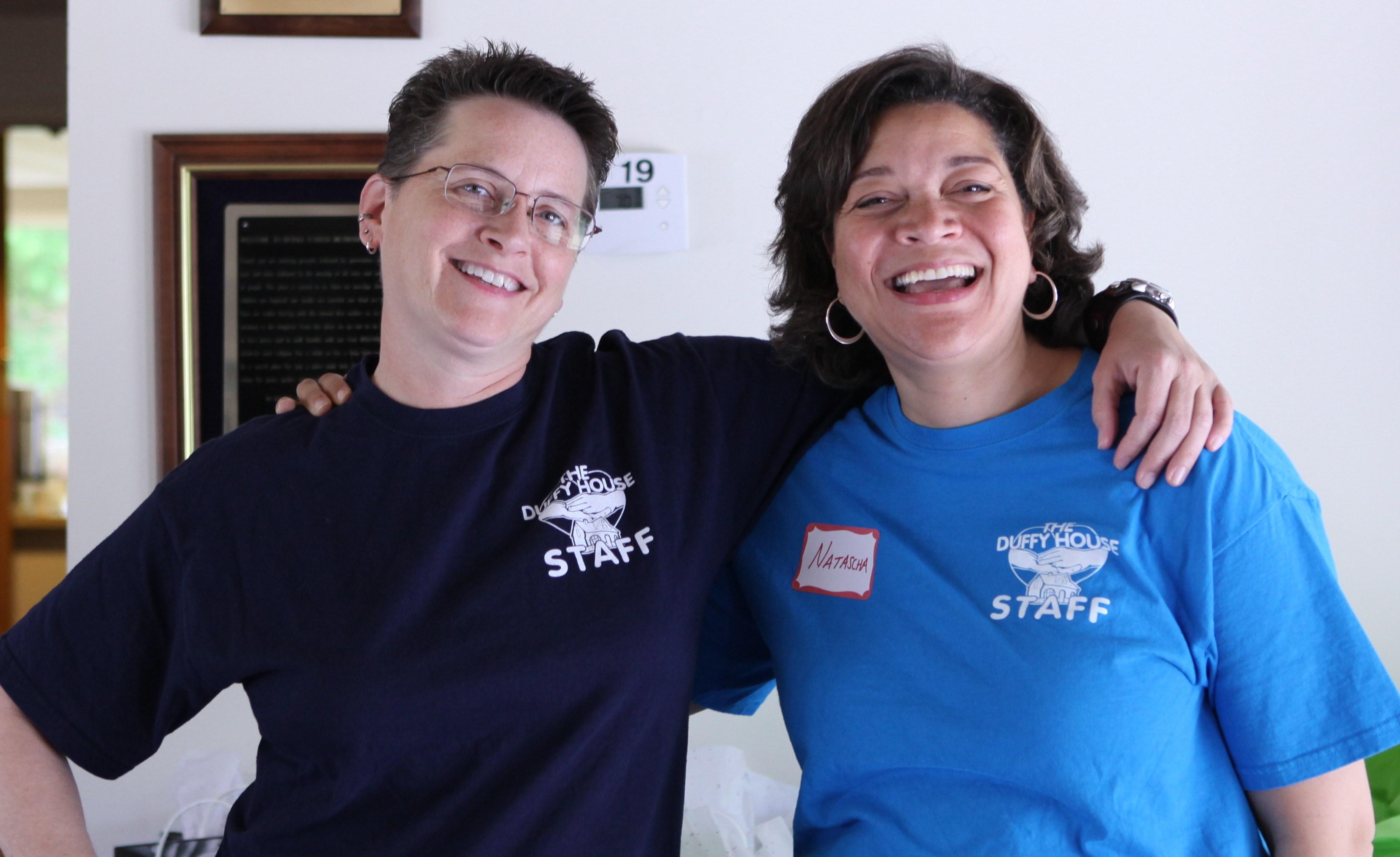 2012-07-02-VolunteersRandiMillerandNataschaDixonhappytohandoutgiftbagstosurvivorsastheyleave.jpg