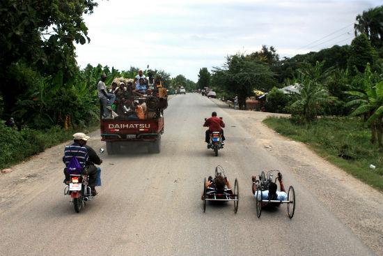 2012-08-28-LeonGaisliwithhiscoachontheirfirstlongdistanceridethroughCapHaitien.JPG