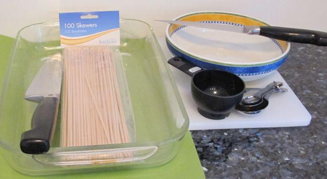 2012-08-30-chickenshishkebabequipmentwithoutplasticwrapmeasuringcupforlemonmixture.jpg