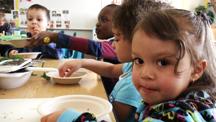 2012-11-29-preschoolerstryingcarrots.jpg