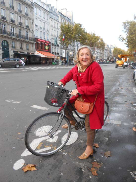 2013-01-03-1pariswomanredcoatonbicyclelr.jpg