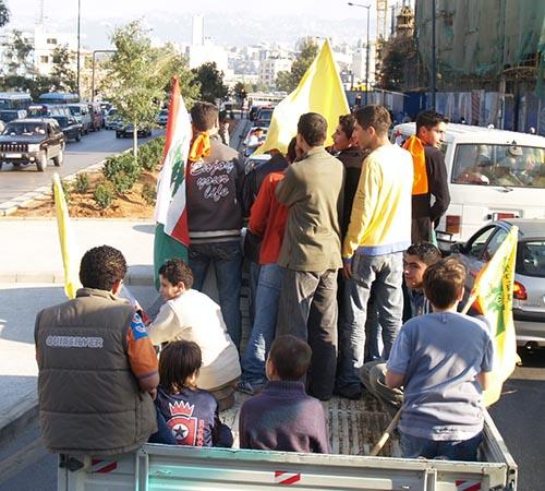 2013-02-05-LebaneseyouthcarryingpoliticalpartyflagsAbuFadil.jpg
