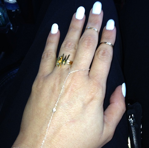 Kardashian Bands: Kim Kardashian Ring: Reality Star Shows Off 'KW' Bling On