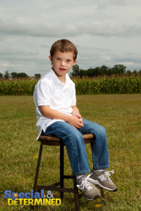 2013-03-07-jacobsittingonchairinfield200x300.png
