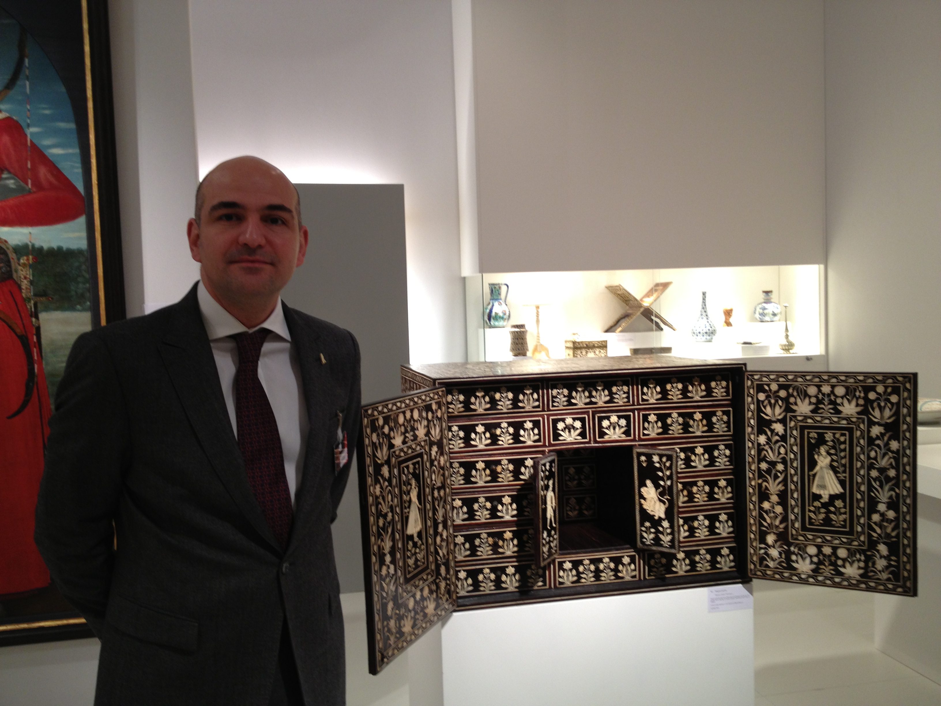 Amir Mohtashemi, a London based Indian and Islamic art dealer, stands in his booth. Credit: Menachem Wecker