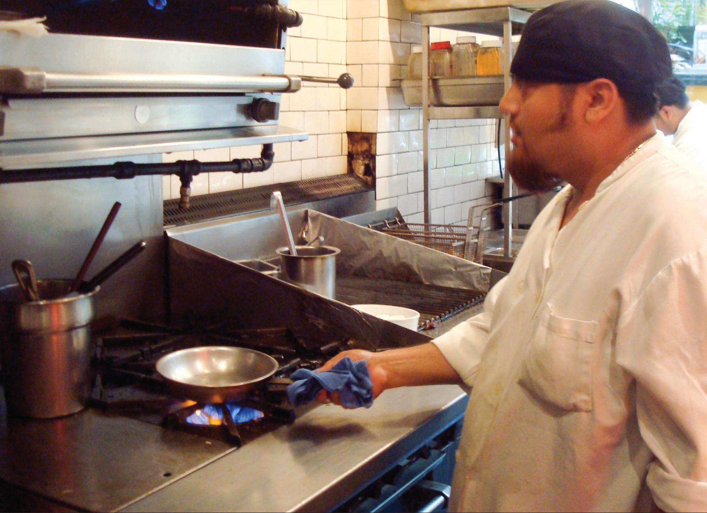2013-05-08-restaurantworkerholdingpan.jpg