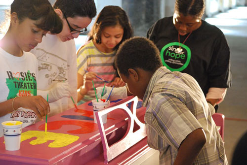 Students from PS34 paint a 2013 Sing for Hope Piano