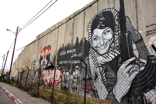 2013-05-17-p12wallartwomanhijacker.jpg & Political Art Decorates the Wall / Security Barrier | HuffPost