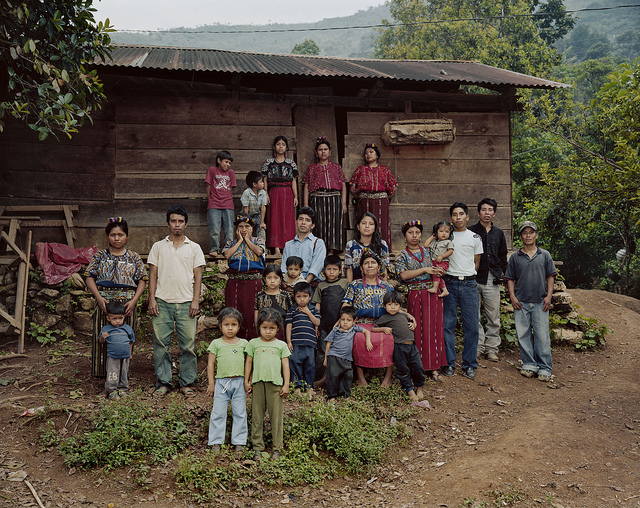 2013-05-22-Granito_CaptionTheCabafamilyinfrontoftheirhomeinIxilhighlandsofGuatemala.Thearmymassacred95peopleintheirvillagein1982duringthegenocide.PhotoCreditDanaLixenberg.jpg