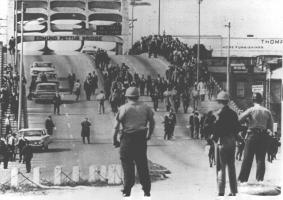 2013-06-30-Bloody_Sundayofficers_await_demonstrators.jpeg
