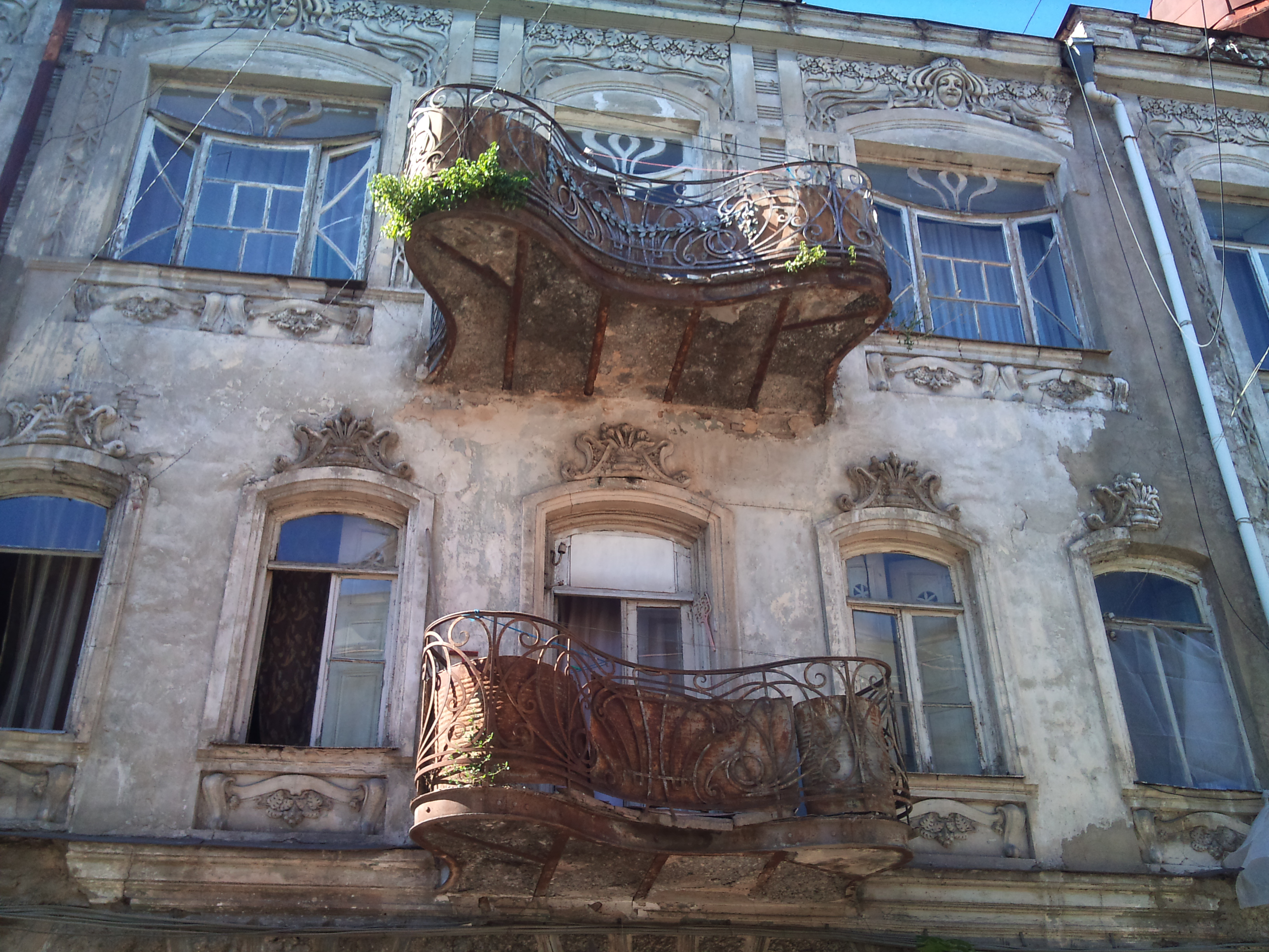 Exploring tbilisi 39 s endangered art nouveau huffpost for How to become a builder in ga