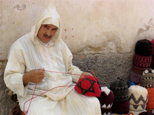 2013-08-06-Moroccomanwithhats.JPG