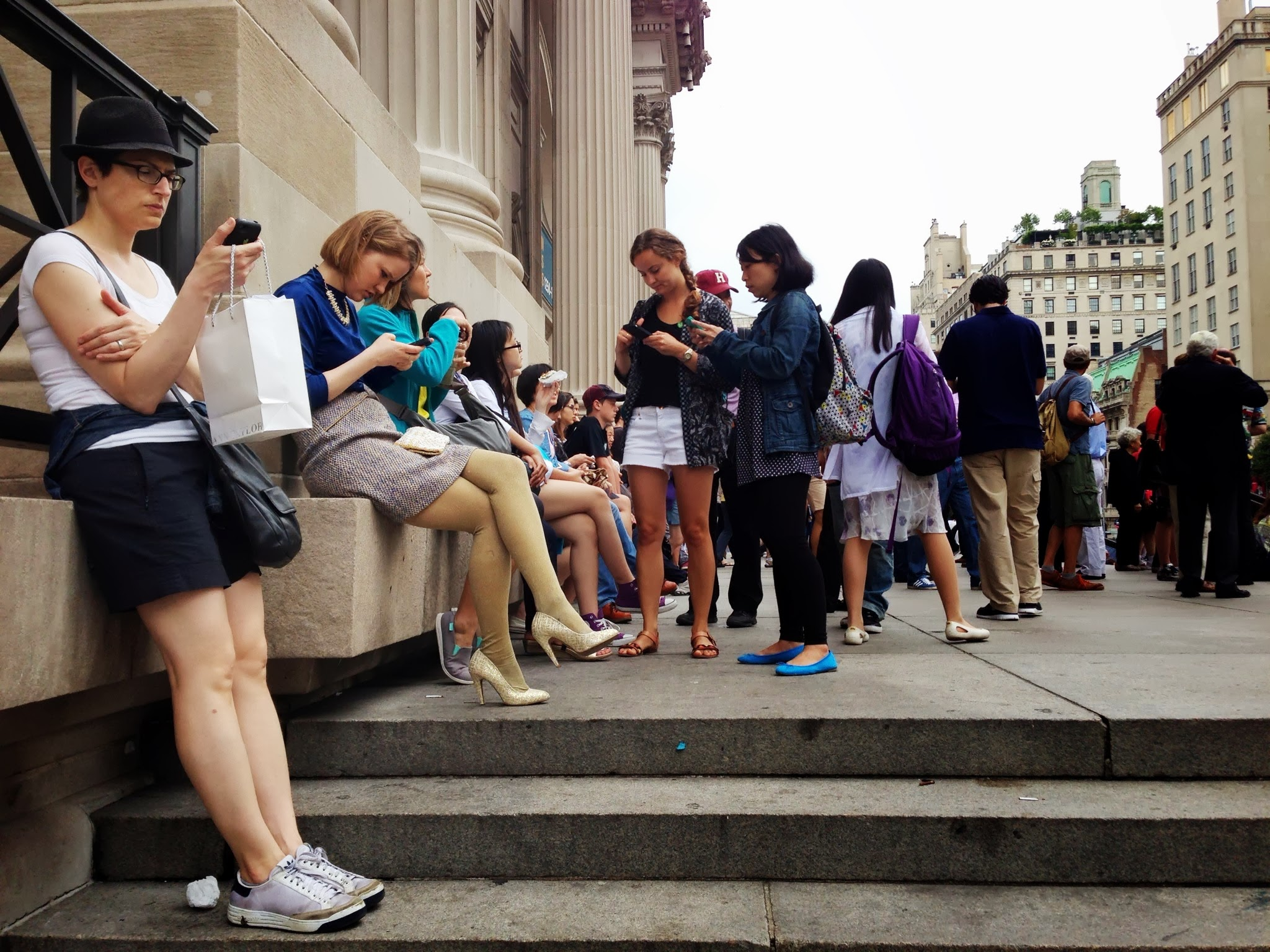 People on the steps of the MET in NYC by Simone Smith