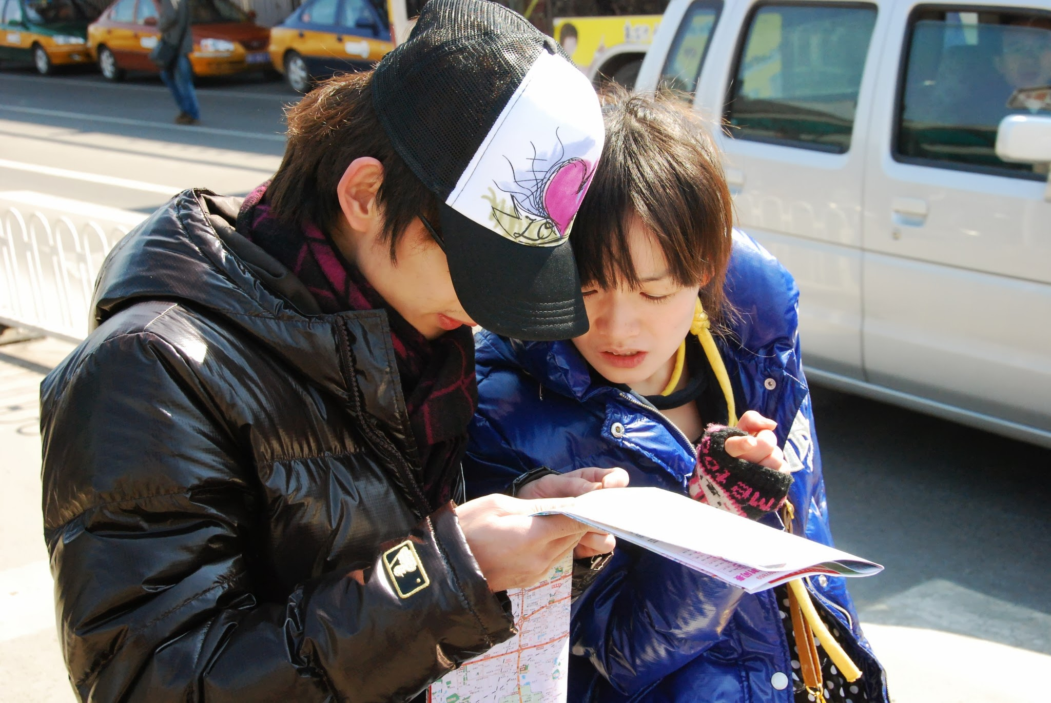 Couple looking at a map by Simone Smith
