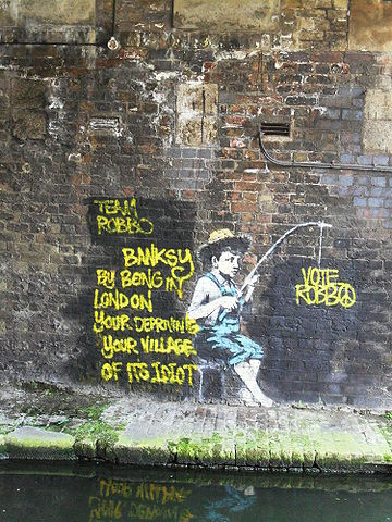 2013-11-01-360pxBanksy_fisherman_mural_Regents_Canal_Camden_London26April2010.jpg