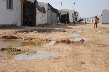 Children play in the puddles of Za'atari Camp. World Vision will be working with UNHCR and other agencies to improve drainage and roads.