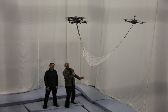 2013-12-19-BNW2EPS6HYPER_CONNECTIONSJim_AlKhalili_tests_quadrocopters_working_working_in_unison_to_perform_astonishing_featsIMG_9870.jpg