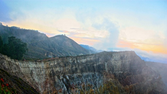 clouds pull back from the Kelimutu volcano