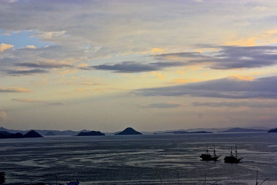 sunset and water currents paint the Labuan Bajo harbor