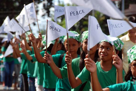 2014-01-28-peaceflagsphotobyRuelD.AmpatinKiambaNewsandInfoCenter.jpg