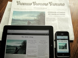 2014-02-26-ipadnewspaperphone.jpg