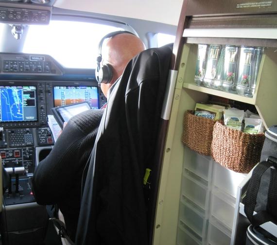 2014-03-03-PrivateJetpieceMinibarandcockpit.JPG