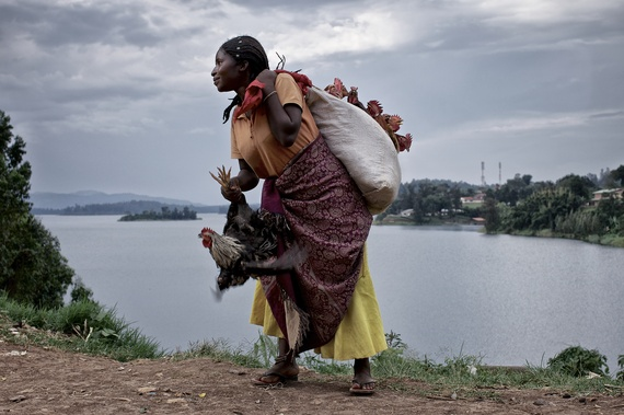 2014-03-10-Crossings_CarolAllenStorey_InternationalAlert_Bukavu_4_Nzigire_chicken_trader.jpg
