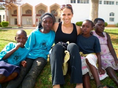 2014-03-12-LaraLandwithsomeofthechildrenofRwanda_Landspentthreemonthsthereteachingyogatosurvivorsofthenationsbrutalgenocide_CourtesyLaraland.jpg