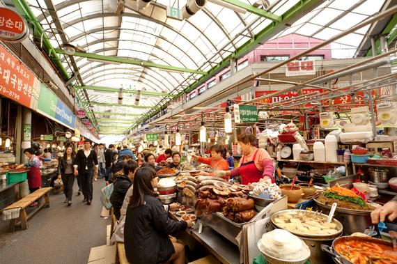 2014-03-24-VendorscookingatGwangjiangMarketinSeoulKorea_editorialonly_cqingqing_shutterstock_148705262.jpg