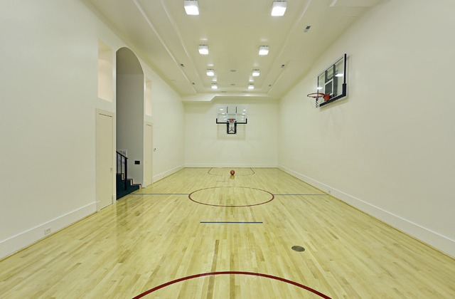 Score points with these 5 slam dunk homes huffpost for Custom indoor basketball court