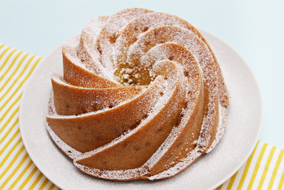 ... Oil-Thyme Bundt Cake With Candied Meyer Lemon Peels and Citrus Compote
