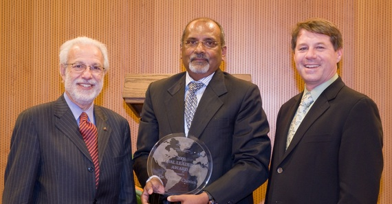 Ciro de Quadros and Orin Levine deliver the PACE Global Leadership Award to WHO's Thomas Cherian, 2010